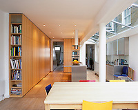 This contemporary kitchen/diner benefits from a glass skylight that runs the length of the room