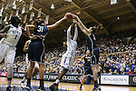 17 December 2013: Duke's Alexis Jones (2) has her shot blocked by UConn's Stefanie Dolson (31) and Breanna Stewart (right). The Duke University Blue Devils played the University of Connecticut Huskies at Cameron Indoor Stadium in Durham, North Carolina in a 2013-14 NCAA Division I Women's Basketball game.
