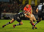 Stephen Jones is tackled by Andrew Blowers. Scarlets V Bristol, EDF Energy Cup  © Ian Cook IJC Photography iancook@ijcphotography.co.uk www.ijcphotography.co.ukUnholy Alliance Tour 2008,