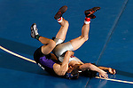 12 MAR 2011:  Todd Wilcox of Grand Canyon (in black and purple) wrestles BJ Young of Newberry during the Division II Men's Wrestling Championship held at the UNK Health and Sports Center on the University of Nebraska - Kearney campus in Kearney, NE.  Wilcox defeated Young 7-2 to win the 133-lb national title.  Corbey R. Dorsey/ NCAA Photos