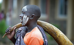 Her face marked with ash, a girl holds a horn--made from a cow's horn--as she prepares to dance at the Loreto Secondary School in Rumbek, South Sudan. The school is run by the Institute for the Blessed Virgin Mary--the Loreto Sisters--of Ireland.