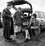 Hare Coursing...A liquid lunch is enjoyed in the members enclosure at the Waterloo Cup. The Waterloo Cup is considered the blue riband, or Ascot, of the hare coursing season. Near Altcar, Lancashire...Hunting with Hounds / Mansion Editions (isbn 0-9542233-1-4) copyright Homer Sykes. +44 (0) 20-8542-7083. < www.mansioneditions.com >..
