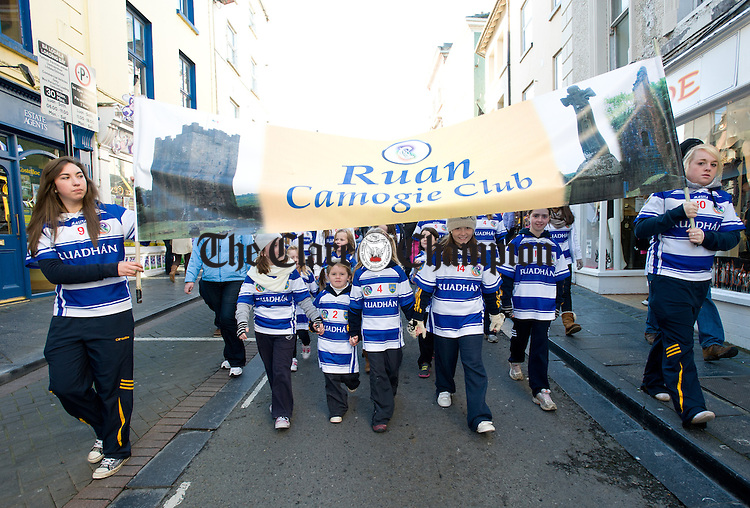 Ruan camogie players in the parade to Cusack Park for the Ireland V Scotland senior hurling shinty International game, to mark the official opening of Fr Mc Namara Memorial Park in Doora. Photograph by John Kelly.