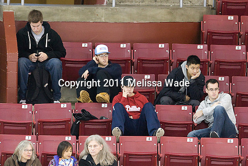 Kevin Pratt (BC - Manager), ?, Johnny Gaudreau (BC - 13), Samson Lee, Tom Maguire (BC - Manager) - The visiting Boston University Terriers defeated the Boston College Eagles 4-1 on Wednesday, November 2, 2011, at Kelley Rink in Conte Forum in Chestnut Hill, Massachusetts.
