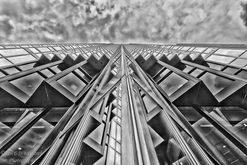 A black and white abstract architectural view looking up the face of the Royal Bank Tower in downtown Toronto.