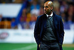 FC Barcelona's head coach Josep Guardiola looks on during the Spanish league football match Levante UD vs FC Barcelona on April 14, 2012 at the Ciudad de Valencia Stadium in Valencia. (Photo by Xaume Olleros/Action Plus)