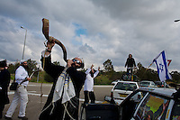 Near Re'im, Israel Dec. 30, 2008.A group of Hassidic jews from the Breslev sect sings and danse near a military check point as it is their belief that everething in ife should be a source of happiness and a way to get closer to God. After several weeks of total closure, Israel has launched its most important military operation ever in the Gaza strip, following Hamas' refusal to extend the 6 months truce.