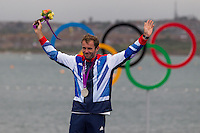 ENGLAND, Weymouth. 7th August 2012. Olympic Games. Men's RS:X Class. Medal Ceremony. Nick Dempsey (GBR) Silver Medalist.