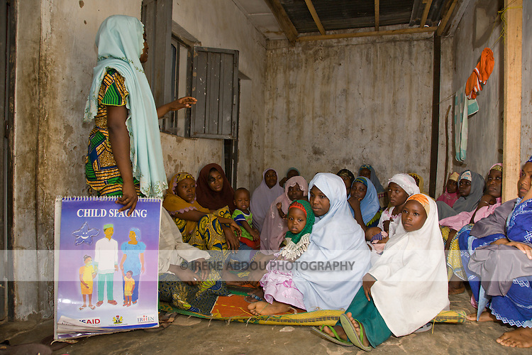 A comunity health volunteer trained by the Society for Family Health speaks to women in Kano, Nigeria about the benefits of child spacing.  The Society for Family Health is Nigeria's largest indigenous NGO, receiving funding from the US and British governments, and other multinational donors.