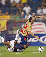 Monarcas Morelia forward Luis Gabriel Rey (18) awarded a penalty kick on this collision with New England Revolution defender Darrius Barnes (25). Monarcas Morelia defeated the New England Revolution, 2-1, in the SuperLiga 2010 Final at Gillette Stadium on September 1, 2010.
