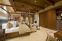 Elegant large master suite with poster bed and sitting area