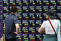 June 21, 2010 - Tokyo, Japan - Pedestrians look at an electronic stock board outside a securities firm in Tokyo, Japan, on June 21, 2010. The Nikkei 225 Stock Average rose 242.99 points, or 2.4%, to 10238.01, its highest closing level since May 18.