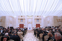 """Pope Benedict XVI sits near Jordanian Prince Ghazi bin Mohammed (front-R), his wife Areej (back 3rd-R), Jordanian MP and member of the Muslim Brotherhood Hayat al-Musemi (2nd-R) and Jordan's Chief of Islamic Justice Ahmad Hilayel at the King Hussein bin Talal Mosque in Amman on May 9, 2009. Pope Benedict XVI condemned """"ideological manipulation of religion"""" and called for reconciliation between Christians, Jews and Muslims on the second day of his Holy Land tour"""