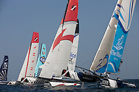 Extreme Sailing Series 2011. Leg 1. Muscat. Oman.The fleet during a practice day.