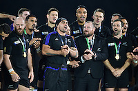 Liam Messam of New Zealand leads his team into a song on the winners' podium. Rugby World Cup Final between New Zealand and Australia on October 31, 2015 at Twickenham Stadium in London, England. Photo by: Patrick Khachfe / Onside Images
