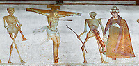 Crucifiction fresco on the Church of San Vigilio in Pinzolo, part of its mural painting &ldquo;the Dance of Death&rdquo; painted by Simone Baschenis of Averaria in1539, Pinzolo, Trentino, Italy.<br /> <br /> The mural continues for another 21 meters with a long procession with 40 figures.<br /> <br />  To the right of the skeletons playing music is a depiction of the crucification. Christ is depicted on the cross with an arrow in him that has been fired by a skeleton with a bow. This suggests that because Christ was a man he suffered the fate of death as we all will.<br /> After Christ is a Pope also pierced by a spear, as are all the human figures in the mural.