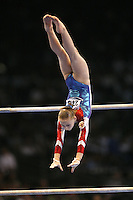 Sept 8, 2007; Stuttgart, Germany; Ksenia Semenova of Russia recatches on way to winning gold in women's artistic gymnastics uneven bars event final at 2007 World Championships. Photo by Tom Theobald. Copyright 2007 by Tom Theobald