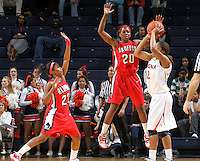 Dec. 6, 2010; Charlottesville, VA, USA; Radford Highlanders guard Da'Naria Erwin-Spencer (22) and Radford Highlanders guard/forward Brooke McElroy (20) defend Virginia Cavaliers guard Whitny Edwards (2) at the John Paul Jones Arena.  Mandatory Credit: Andrew Shurtleff