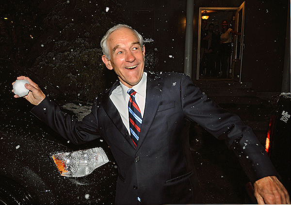 Hollis, New Hampshire: October 27, 2011 (Focus is Soft)<br /> Amid falling snow, presidential candidate Ron Paul tosses a snowball at a campaign aide. He had stepped outside a private residence following a campaign event. The early season snowfall surprised him. He grinned and stated that he wanted to throw a snowball. He scooped a handful of the white stuff from the back of a pickup truck. &copy;Chris Fitzgerald / Candidate Photos