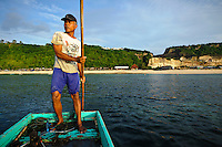 Bapak I Nyoman Yasa traveling out to his seaweed farm, Kutuh, Bali, Indonesia.