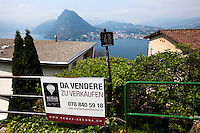 Switzerland. Canton Ticino. Aldesago. Real estate billboard. Construction of private houses on a deluxe standing. View on the lake of Lugano ( also called Lago Ceresio).  Aldesago is distant 5 km from Lugano. 2.06.12 © 2012 Didier Ruef