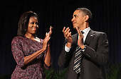 United States President Barack Obama(right) and First Lady Michelle Obama(left) applaud at the National Prayer Breakfast in Washington, DC, February 2, 2012. .Credit: Chris Kleponis / Pool via CNP