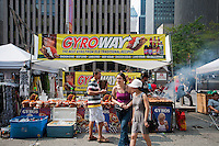 A kiosk selling gyros and kebabs copies the Subway Sandwich shop logo and name at a street fair in New York seen on Sunday, September 4, 2011. ( © Richard B. Levine)
