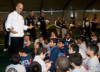 White House assistant chef Sam  Kass speaks to a group of local children about nutrition during a US Soccer Foundation clinic held at City Center in Washington, DC.