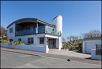 BNPS.co.uk (01202 558833)<br /> Pic: Jackson-Stops/BNPS<br /> <br /> ****Must use full byline****<br /> <br /> A stunning cliff-top house has grown into a 1.25 million pounds property after it was built on a disused allotment.<br /> <br /> Jamie and Zoe McLintock forked out &pound;80,000 for the overgrown plot of land eleven years ago because it was atop a cliff along Devon's craggy coastline.<br /> <br /> The enterprising couple spent a further &pound;600,000 and three years of their time building the beautiful five-bedroom pad.<br /> <br /> But they are now set to double their money after the incredible property went on the market for a whopping &pound;1.25 million with estate agents Jackson-Stops.<br /> <br /> The white-washed three-storey house is perched on top of 100ft cliffs overlooking Tunnels Beaches in Ilfracombe, a stretch of private Victorian beach owned by the couple since 2001.