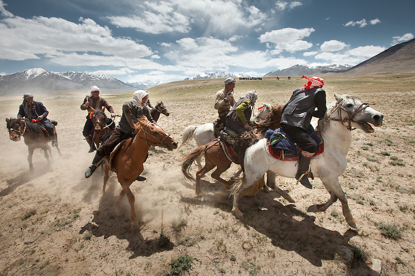 Kyrgyz men fight in a game of Buzkashi, a competition akin to polo?except a headless goat carcass takes the place of the ball. .Buzkachi is almost exclusively played during weddings..Probably one of the great pleasures in the life of a Kyrgyz man, Buzkashi is Afghanistan's national sport. The Kyrgyz call it ulak tartysh, or ?goat grabbing.?.At the wedding celebration at Kitshiq Aq Jyrga...Trekking through the high altitude plateau of the Little Pamir mountains (average 4200 meters) , where the Afghan Kyrgyz community live all year, on the borders of China, Tajikistan and Pakistan.