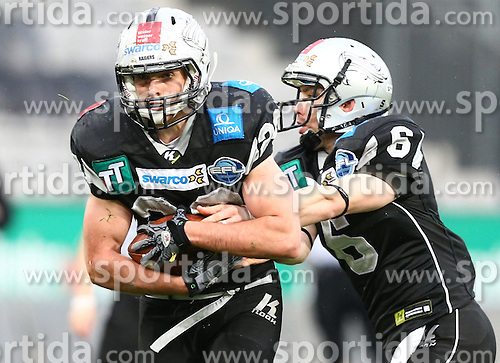 04.05.2013, Tivoli Stadion, Innsbruck, AUT, AFL, Swarco Raiders Tirol vs Prag Black Panthers, im Bild Andreas Hofbauer, (SWARCO Raiders Tirol, RB, #29) und Kyle Callahan, (SWARCO Raiders Tirol, QB, #6)  // during the Austrian Football League Game between Swarco Raiders Tirol and Prague Black Panthers at the Tivoli Stadion, Innsbruck, Austria on 2013/05/04. EXPA Pictures © 2013, PhotoCredit: EXPA/ Thomas Haumer