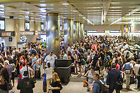 Thousands pack Penn Station in New York to get out of the city for the Memorial Day weekend on Friday, May 27, 2016. Every Friday during the summer the train, consisting of double-decker cars pulled by a powerful dual-mode locomotive, will run express to Westhampton on Long Island making the 76 mile trip in 94 minutes. From Westhampton it will continue to points east arriving at the tip of the island, Montauk. On Sundays the train will reverse and return to Penn Station. The train is the only named run on the railroad. The trip from Penn Station to the Montauk terminal is 117 miles making the train the longest run on the railroad. (© Richard B. Levine)