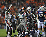 Ole Miss' Damien Jackson (1) and Ole Miss' Charles Sawyer (3) celebrate a fumble recovery at Jordan-Hare Stadium in Auburn, Ala. on Saturday, October 29, 2011. Ole Miss' Kentrell Lockett (40) recovered the ball..