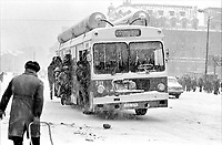 "ROMANIA, University Square, Bucharest, 12.1984.Bus with empty gas cylinders - ""Comrade"" Elena Ceausescu had requested the use of LPG, to save fuel. But the tanks on the buses were always empty, because LPG did not yet exist..© Andrei Pandele / EST&OST"