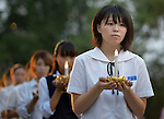 A girl carries a candle in a procession at the beginning of an interfaith service in Nagasaki, Japan, to commemorate those who died as the result of the U.S. atomic bomb dropped on the city in 1945. Participants in the service, which took place at the hypocenter of the blast, included a team of pilgrims from the World Council of Churches who came to Japan to see for themselves the results of the bombings 70 years ago, to listen to survivors and local church leaders, and to recommit themselves to new forms of advocacy for a world free of nuclear weapons.