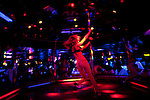 A dancer swings from the pole at the world famous Mons Venus strip club in Tampa, Florida.
