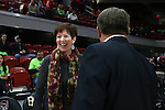 29 December 2016: Notre Dame head coach Muffet McGraw (left) meets NC State head coach Wes Moore (right) before the game. The North Carolina State University Wolfpack hosted the University of Notre Dame Fighting Irish at Reynolds Coliseum in Raleigh, North Carolina in a 2016-17 NCAA Division I Women's Basketball game. NC State won the game 70-62.
