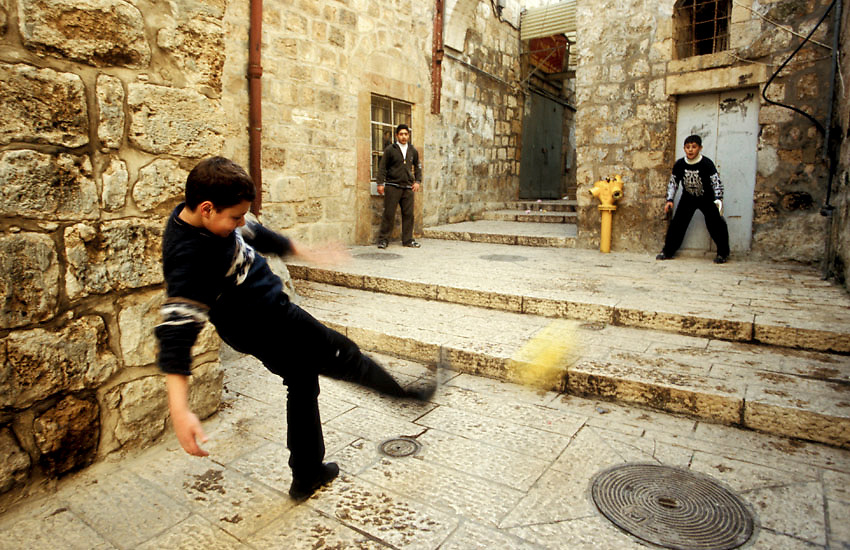 A group of boys play soccer in the maze-like streets of Jerusalem's Old City, Israel/Palestine, February 2006. Photo: Ed Giles.