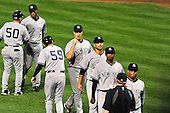New York Yankees first baseman Mark Teixeira (25) and his teammates celebrate their 3 - 2 victory over the Baltimore Orioles at Oriole Park at Camden Yards in Baltimore, Maryland on Monday, August 29, 2011.  .Credit: Ron Sachs / CNP.(RESTRICTION: NO New York or New Jersey Newspapers or newspapers within a 75 mile radius of New York City)