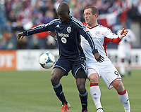 Sporting Kansas City defender Ike Opara (3) controls pass targeted for New England Revolution forward Chad Barrett (9).  In a Major League Soccer (MLS) match, Sporting Kansas City (blue) tied the New England Revolution (white), 0-0, at Gillette Stadium on March 23, 2013.