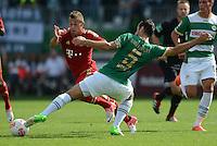 Fussball 1. Bundesliga :  Saison   2012/2013   1. Spieltag  25.08.2012 SpVgg Greuther Fuerth - FC Bayern Muenchen Xherdan Shaqiri (li, FC Bayern Muenchen) gegen Mergim Mavraj (Greuther Fuerth)