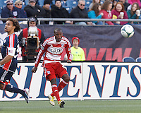 FC Dallas midfielder Jackson Goncalves (6) crosses the ball. .  In a Major League Soccer (MLS) match, FC Dallas (red) defeated the New England Revolution (blue), 1-0, at Gillette Stadium on March 30, 2013.
