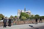 View of Notre Dame from Archbishop's Bridge, Pont de L'Archeveche,  covered in locks, Paris, France