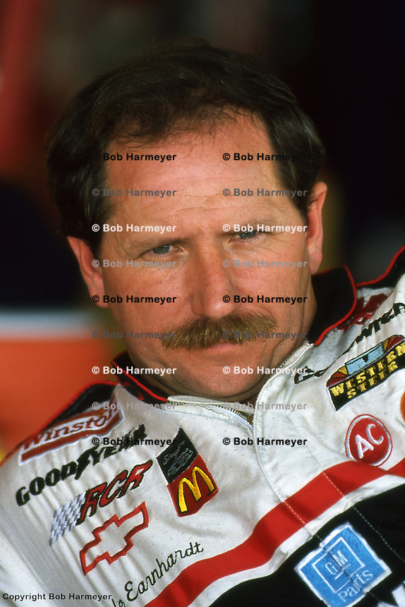CHARLOTTE, NC - OCTOBER 6: Dale Earnhardt in the garage area during practice for the Mello Yello 500 on October 6, 1991, at the Charlotte Motor Speedway near Charlotte, North Carolina.