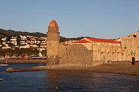 Eglise Notre Dame des Anges and Plage Saint Vincent, Collioure, France. The bell tower was converted from a medieval lighthouse and the Mediterranean Gothic style nave was built in 1684. The dome was added to the bell tower in 1810. Picasso, Matisse, Derain, Dufy, Chagall, Marquet, and many others immortalized the small Catalan harbour in their works. Picture by Manuel Cohen.