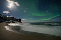 Full moon and northern lights over Unstad beach, Vestvågøy, Lofoten Islands, Norway