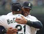 Seattle Mariners' designated hitter Nelson Cruz hugs manager Lloyd McClendon during introductions before their game against theLos Angeles Angels in the  season home opener April 6, 2015 at Safeco Field in Seattle.  The Mariners beat the Angels 4-1.       ©2015. Jim Bryant Photo. ALL RIGHTS RESERVED.