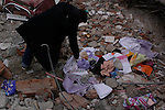 VAN, TURKEY: A man searches through the rubble after a 7.2 magnitude earthquake hit eastern Turkey...On October 23, 2011, a 7.2 magnitude earthquake hit eastern Turkey killing over 250 people and wounding over a thousand...Photo by Ali Arkady/Metrography