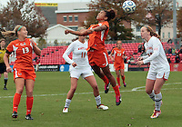COLLEGE PARK, MD - OCTOBER 28, 2012:  Danielle Hubka (34) of the University of Maryland loses a header to Jasmine Paterson (15) of Miami during an ACC  women's tournament 1st. round match at Ludwig Field in College Park, MD. on October 28. Maryland won 2-1 on a golden goal in extra time.
