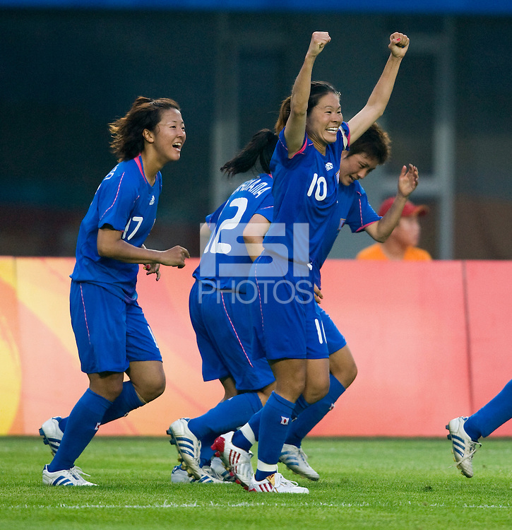 Japanese captain (10) Homare Sawa celebrates her goal during first round play in the 2008 Beijing Olympics at Qinhuangdao, China. .  Japan tied New Zealand, 2-2, at Qinhuangdao Stadium.